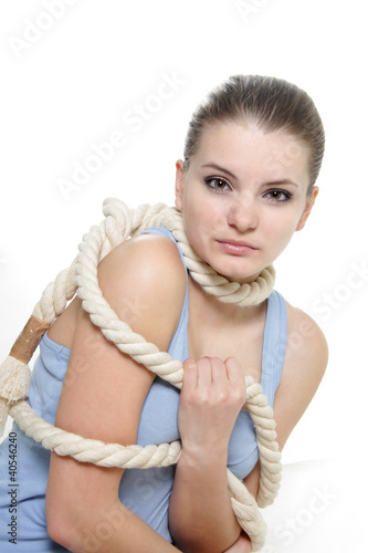woman tied up with rope over white