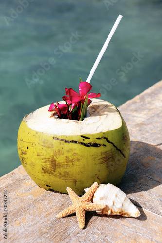 coconut drink and sea