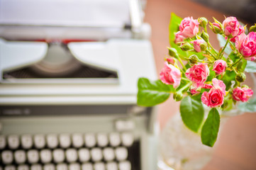 roses and old type-writer