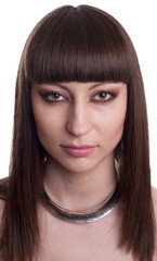 Attractive brunette with a egyptian style make up and hair.