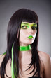Portrait of attractive woman with green make-up