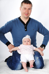 lucky young father with breast child