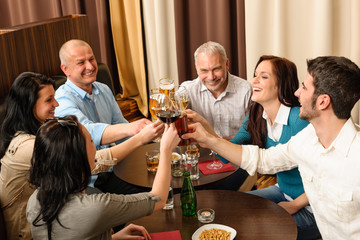 After work happy colleagues enjoy drink
