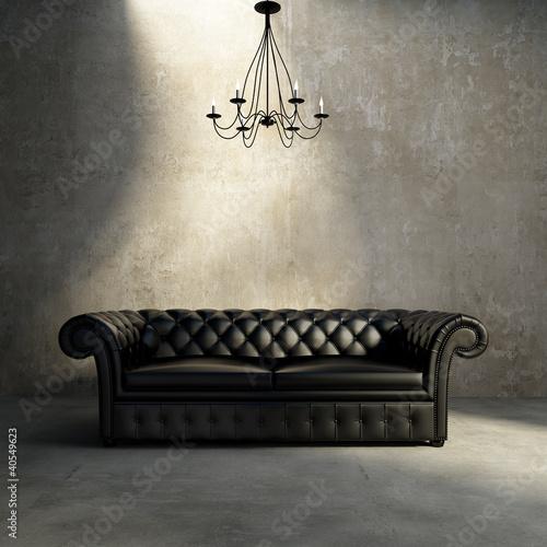 Vintage antique tufted modern classic black sofa, grunge wall