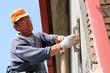 Mason Worker Plastering Wall