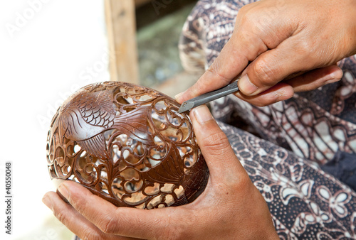 Male hands carving coconut