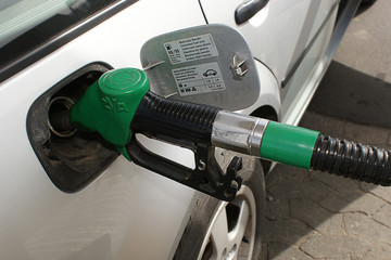 Refueling the car with expensive gasoline