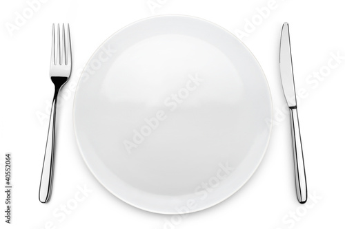 table set with plate, fork and knife on white background
