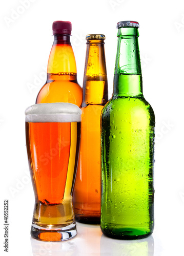 Isolated Glass Beer in plastic bottle and Two glass bottles with