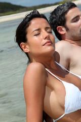 Closeup of woman relaxing in lagoon water