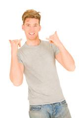 Young man making hang loose hand signals