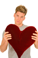 young man with a heart shaped pillow