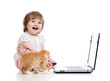 Funny child using a laptop over white background with kitten