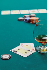 a glass of liquor and cards and dollars