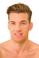 young man with anti-wrinkle cream