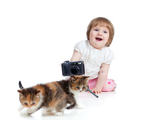 funny child shooting Scottish kitten
