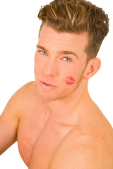 young man with the imprint of a kiss on the face