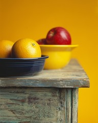 Two Bowls of Fruit on a Table; Oranges and Apples