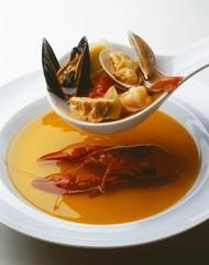 Ladling Seafood Stew into Bowl