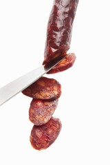 Chorizo being sliced