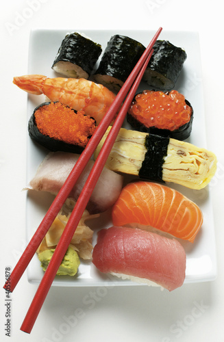 Mixed sushi platter with red chopsticks