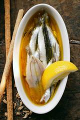 Marinated sardines with lemon and grissini