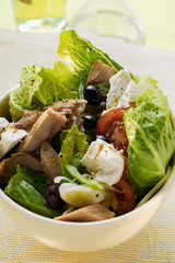 Romaine lettuce with tuna, sheep's cheese, tomatoes & olives