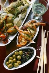 Antipasti platter, scampi and olives; grissini