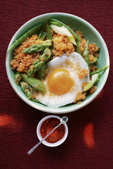 Quinoa with ajvar, green asparagus and fried egg