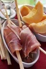 Parma ham with grissini; melon