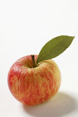 A fresh apple with stalk and leaf
