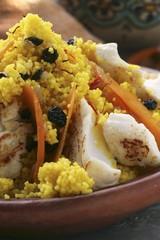Saffron couscous with fish, carrots and raisins (N. Africa)
