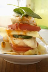 Monkfish lasagne with tomatoes and courgettes