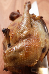 Roast pigeon and knife