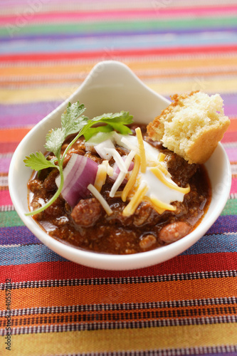 Chili con carne with cheese, sour cream and corn bread