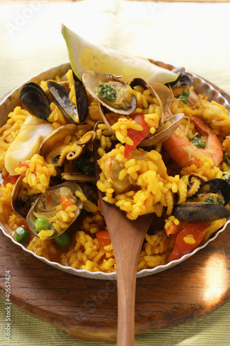 Paella with seafood and wedge of lemon