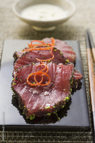 Raw tuna fillets with poppy seeds