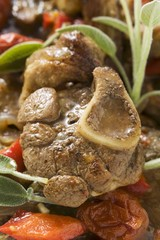 Osso buco with tomatoes and sage (close-up)