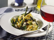Ribbon pasta on green asparagus & gorgonzola; glass of red wine