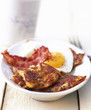Potato pancake with fried egg and bacon