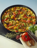 Tortilla with vegetables in frying pan