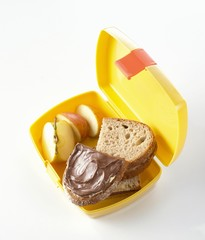 Nutella sandwiches and apple in lunch box