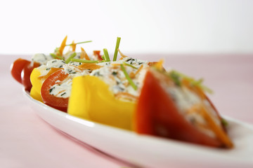 Peppers stuffed with soft cheese and vegetables