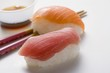 Nigiri sushi with tuna & salmon, chopsticks & soy sauce