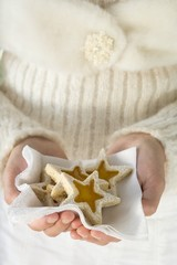 Woman holding star-shaped biscuits