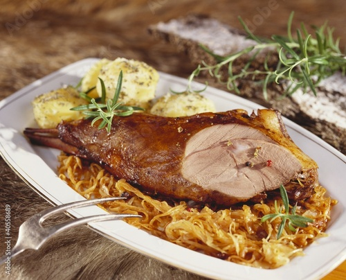 Roast leg of wild boar with sauerkraut and dumplings