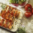 Tomato and mozzarella on skewers with baguette slices