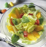 Lettuce with orange segments and tomatoes for Easter