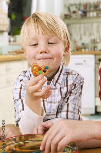 Boy holding a biscuit