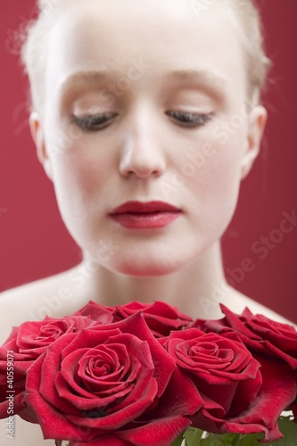 Young woman with a bouquet of red roses